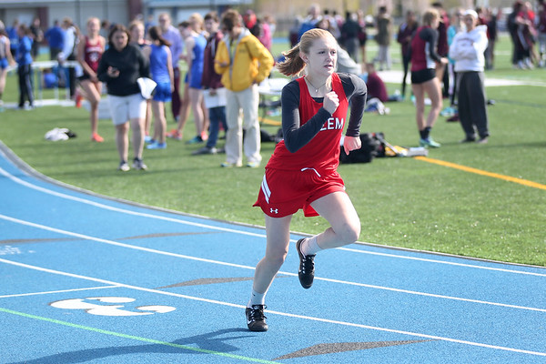 HADLEY GREEN/ Staff photo<br /> Salem's Dani Stotts runs at the Salem v. Lynn track meet at Danvers High School on Tuesday, April 18th, 2017.