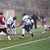 HADLEY GREEN/ Staff photo<br /> Gloucester's Kyle Aquipel (4) scores on Swampscott's goalie Perlin (25) at the Swampscott v. Gloucester boys lacrosse game at the Bertram Athletic Field in Salem on Friday, April 21st, 2017.