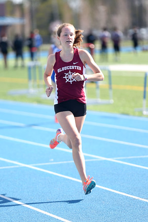 HADLEY GREEN/ Staff photo<br /> Gloucester's Eve Feuerbach runs at the Danvers v. Gloucester track meet at Danvers High School on Tuesday, April 18th, 2017.