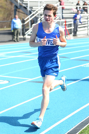 HADLEY GREEN/ Staff photo<br /> Danvers' Alex Douyotas runs at the Danvers v. Gloucester track meet at Danvers High School on Tuesday, April 18th, 2017.
