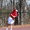 HADLEY GREEN/ Staff photo<br /> Marblehead's Reid Tully jumps to hit the ball while playing with his doubles partner Tony Gluskin at the Marblehead v. Gloucester boys tennis match at Marblehead High School on Monday,  April 17th, 2017.