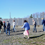 HADLEY GREEN/ Staff photo People walk through the Greenergy Park Solar Field on Friday, April 14th, 2017. Local and state environmental groups gathered at the park Friday afternoon to discus ...