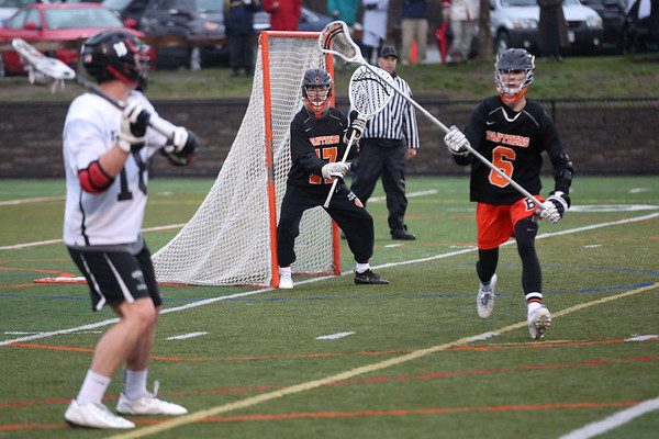 HADLEY GREEN/ Staff photo<br /> Beverly goalie Kevin Morency (17) guards the net while Marblehead's Manning Sears (18) prepares to shoot and Beverly's Connor Cadematori (6) plays defense at the Marblehead v. Beverly boys varsity lacrosse game held at Marblehead High School on Tuesday, April 25th, 2017.