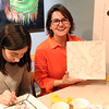HADLEY GREEN/ Staff photo<br /> Elizabeth Albee of Marblehead shows her pottery piece that she painted at Paint and Sip Pottery Night with Patti DiCarlo Baker & Hestia Studios on April 14th, 2017.