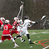 HADLEY GREEN/ Staff photo<br /> Marblehead's Luke Anderson (11) shoots surrounded by Masco defense at the Masco vs Marblehead boys varsity lacrosse game held at Marblehead High on Wednesday, April 5th, 2017.