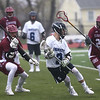 HADLEY GREEN/ Staff photo<br /> Swampscott's Dove (3) cradles the ball while Gloucester's James Nelson (21) and Brendan O'Brien (7) play defense at the Swampscott v. Gloucester boys lacrosse game at the Bertram Athletic Field in Salem on Friday, April 21st, 2017.
