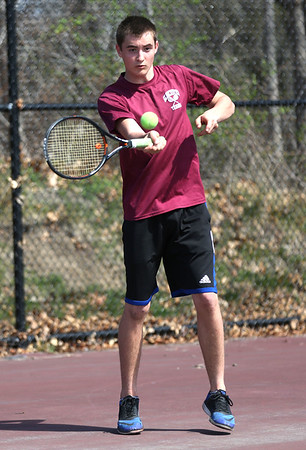 HADLEY GREEN/ Staff photo<br /> Gloucester's Derek Hopkins hits the ball at the Marblehead v. Gloucester boys tennis match at Marblehead High School on Monday,  April 17th, 2017.