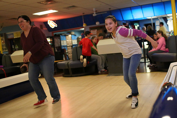 HADLEY GREEN/ Staff photo<br /> Phoebe Ting, right, and her mother Maribeth of Wenham bowl together at Sunnyside Bowladrome in Danvers on Friday, April 21st, 2017.