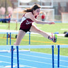 HADLEY GREEN/ Staff photo<br /> Gloucester's Liz Kuhns leaps over a hurdle at the Danvers v. Gloucester track meet at Danvers High School on Tuesday, April 18th, 2017.