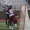 HADLEY GREEN/ Staff photo<br /> Gloucester goalie Owen Brown (15) blocks Swampscott's Laundry (2) at the Swampscott v. Gloucester boys lacrosse game at the Bertram Athletic Field in Salem on Friday, April 21st, 2017.
