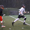 HADLEY GREEN/ Staff photo<br /> Marblehead's Aidan Gillis (9) runs up the field chased by Beverly's defense at the Marblehead v. Beverly boys varsity lacrosse game held at Marblehead High School on Tuesday, April 25th, 2017.
