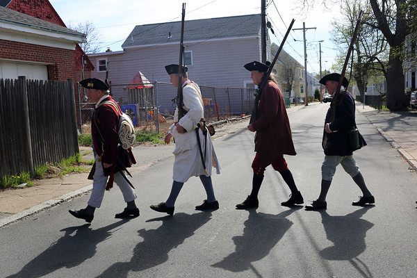 HADLEY GREEN/ Staff photo<br /> Members of the Danvers Alarm List Company walk across Sewall Street at the annual wreath-laying ceremony honoring the fallen soldiers of south Danvers at the Battle of Lexington at the Lexington Monument in Peabody on Monday, April 17th, 2017.