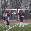 HADLEY GREEN/ Staff photo<br /> Gloucester players Owen Brown (15) and Brendan O'Brien (7) bump fists after scoring during the Swampscott v. Gloucester boys lacrosse game at the Bertram Athletic Field in Salem on Friday, April 21st, 2017.