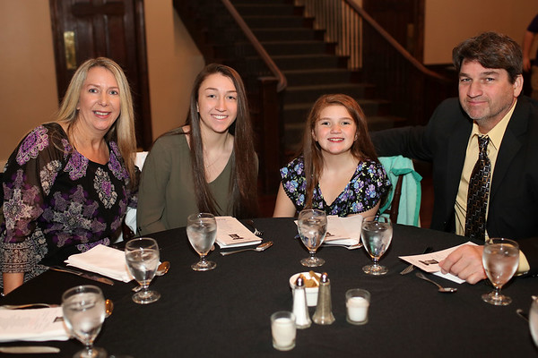 HADLEY GREEN/ Staff photo<br /> From left to right, Donna, Sam, Sienna, and Mark Mancinelli attend the Salem News Student Athlete Award dinner on Thursday, April 6th, 2017.