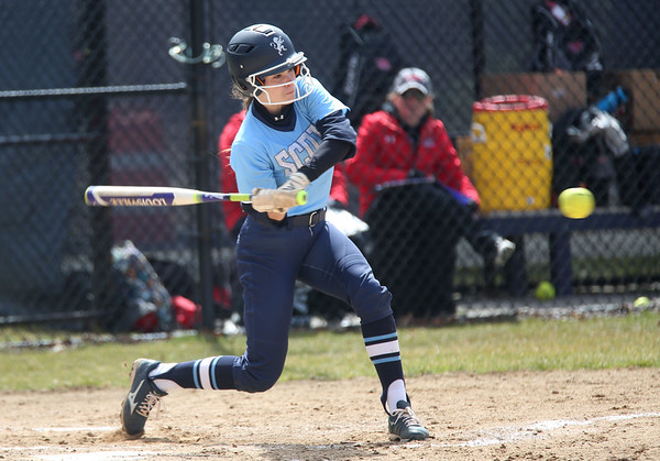 HADLEY GREEN/ Staff photo<br /> Gordon's Rose Shannon (6) hits the ball at the Gordon College v. Eastern Nazarene College girls varsity softball game at Gordon College on Saturday, April 8th, 2017.