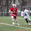 HADLEY GREEN/ Staff photo<br /> Marblehead's Drew Cioffi (4) moves down the field while Masco's Max Sherriff-Streng (6) plays defense at the Masco vs Marblehead boys varsity lacrosse game held at Marblehead High on Wednesday, April 5th, 2017.