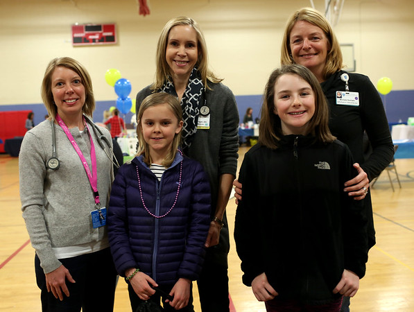 HADLEY GREEN/ Staff photo<br /> From left to right, Rebecca Orendorff, Maria Fagan and Michelle Gorham, all of the North Shore Physicians Group, attend the Health and Wellness Fair along with Fagan's daughter Madeline, and Gorham's daughter Sarah. The fair took place at the Lynch Van Otterloo YMCA in Marblehead on Saturday, April 8th, 2017.