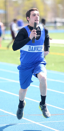 HADLEY GREEN/ Staff photo<br /> Danvers' Will Maurice runs during the boys relay at the Danvers v. Gloucester track meet at Danvers High School on Tuesday, April 18th, 2017.