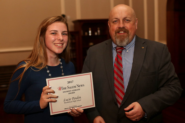 HADLEY GREEN/ Staff photo<br /> Lucy Poulin of Marblehead High is recognized as she stands next to Salem News editor Dave Olson at the Salem News Student Athlete Award dinner at Rockafellas in Salem on Thursday, April 6th, 2017.