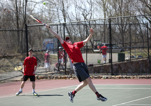 HADLEY GREEN/ Staff photo<br /> Luke Fobert hits the ball while playing doubles with his teammate Jacob Hubbard at the Marblehead v. Gloucester boys tennis match at Marblehead High School on Monday,  April 17th, 2017.