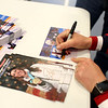HADLEY GREEN/Staff photo<br /> Meghan Duggan signs autographs for community members and youth hockey players at the Meghan Duggan Day celebration at Danvers High School.<br /> <br /> 04/07/18