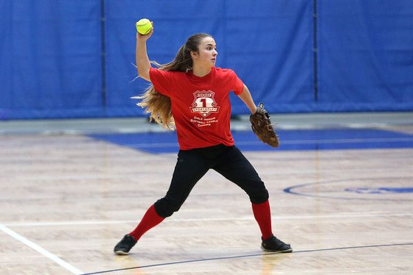 HADLEY GREEN/Staff photo<br /> Second baseman Makayla Iannalfo throws to her teammate at the Peabody High School girls softball practice.<br /> <br /> 04/04/18