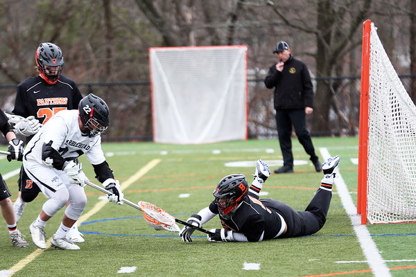 HADLEY GREEN/Staff photo<br /> Beverly's Berchoff (5) makes a save at the Marblehead v. Beverly boys lacrosse game at Marblehead High School.<br /> <br /> 04/19/18