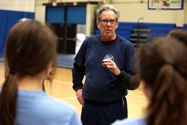 HADLEY GREEN/Staff photo<br /> Coach Butch Melanaphy speaks to his team at the Peabody High School girls softball practice.<br /> <br /> 04/04/18