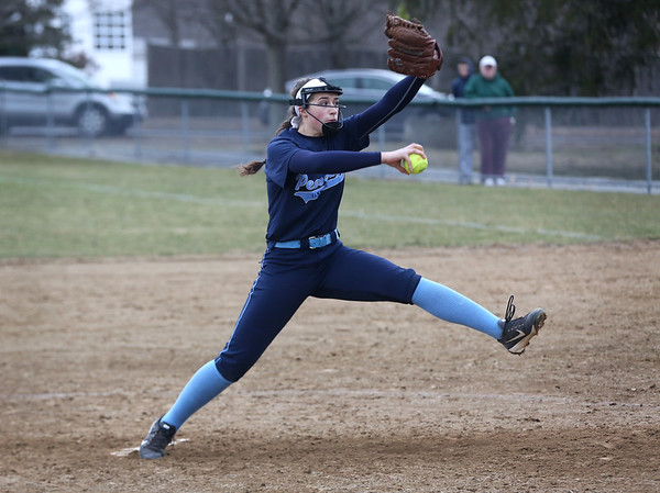 HADLEY GREEN/Staff photo<br /> Peabody's Tianna Dawe (14) pitches at the Danvers v. Peabody girls softball game.<br /> <br /> 04/10/18