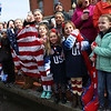 HADLEY GREEN/Staff photo<br /> Community members cheer for Meghan Duggan as she arrives in a fire truck at the Meghan Duggan Day celebration in Danvers center.<br /> <br /> 04/07/18