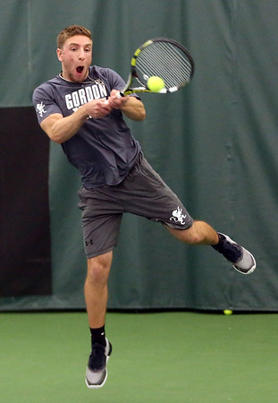 HADLEY GREEN/Staff photo<br /> Gordon's Mike D'Antuono jumps for the ball at the Endicott College v. Gordon College boys tennis match.<br /> <br /> 04/06/18