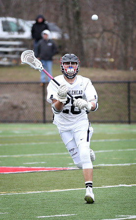 HADLEY GREEN/Staff photo<br /> Marblehead's Will Crugar (28) passes the ball at the Marblehead v. Beverly boys lacrosse game at Marblehead High School.<br /> <br /> 04/19/18