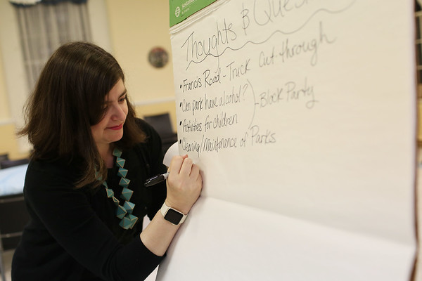 HADLEY GREEN/Staff photo<br /> Lisa Peterson takes notes during a neighborhood meeting she organized for residents in her ward. <br /> <br /> 04/26/18