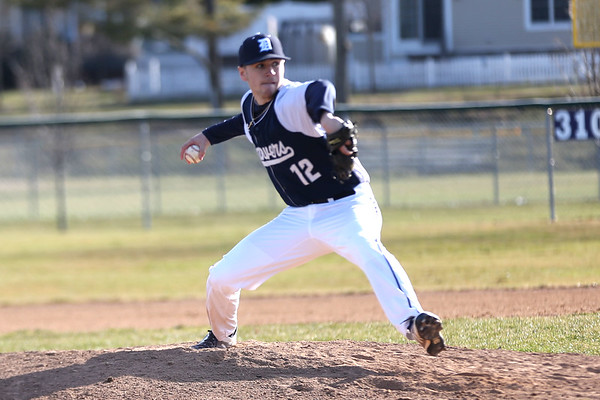 HADLEY GREEN/Staff photo<br /> Danvers' Justin Roberto (12) pitches at the Danvers v. Salem boys baseball game at Twi Field in Danvers.<br /> <br /> 04/09/18