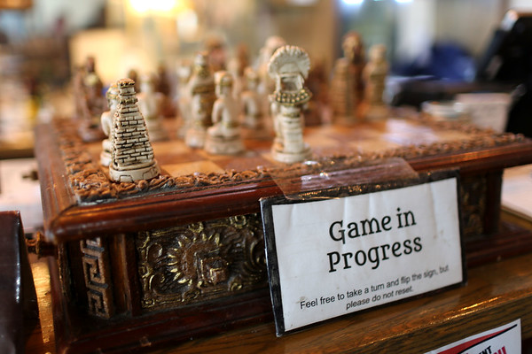 HADLEY GREEN/Staff photo<br /> A chess game is played between customers and staff at The Castle in Beverly.<br /> <br /> 04/09/18