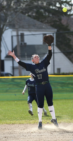 HADLEY GREEN/Staff photo<br /> Essex Tech's Emily Brown jumps for a ball at the Marblehead v. Essex Tech softball game at Marblehead Veterans Middle School.<br /> <br /> 04/17/18