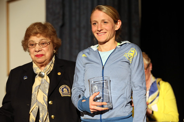 HADLEY GREEN/Staff photo<br /> Andover native Rachel Hyland stands with Gloria Ratti, BAA vice president, at the 122nd Boston Marathon awards ceremony.  <br /> <br /> 04/16/18