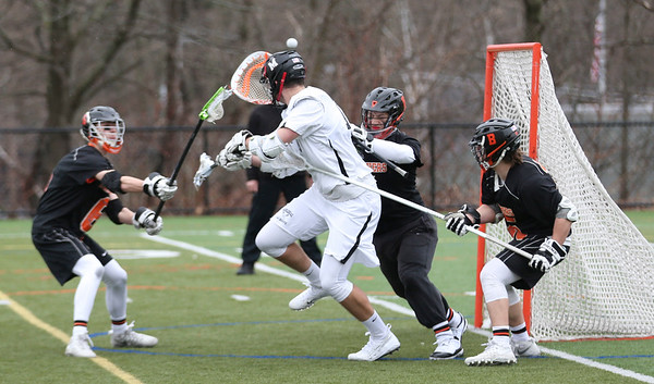 HADLEY GREEN/Staff photo<br /> Marblehead's Andy Clough (17) tries to score while Beverly goalie Berchoff (5) blocks him at the Marblehead v. Beverly boys lacrosse game at Marblehead High School.<br /> <br /> 04/19/18