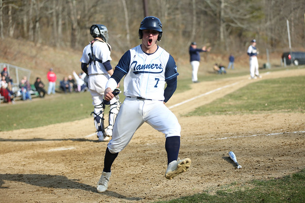 HADLEY GREEN/Staff photo<br /> Peabody's Jake Gustin (7) celebrates after scoring at the Peabody v. Danvers baseball game.<br /> <br /> 04/11/18
