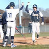 HADLEY GREEN/Staff photo<br /> Danvers' Anthony Olszak (11) and Matt King (7) high five as King runs through home plate at the Danvers v. Salem boys baseball game at Twi Field in Danvers.<br /> <br /> 04/09/18