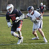 HADLEY GREEN/Staff photo<br /> Ipswich's Pat Gillis (10) moves the ball while Hamilton-Wenham's Henry Schibli (16) defends him at the Hamilton-Wenham v. Ipswich boys lacrosse game.<br /> <br /> 04/24/18