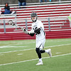HADLEY GREEN/Staff photo<br /> Marblehead's Loch Sheridan (20) looks for an open pass at the Marblehead v. Beverly boys lacrosse game at Marblehead High School.<br /> <br /> 04/19/18