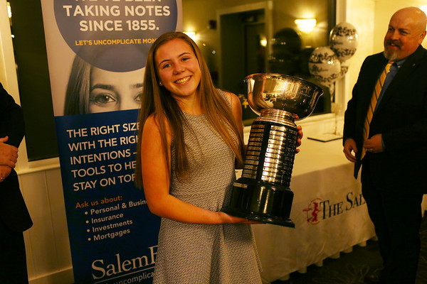 HADLEY GREEN/Staff photo<br /> Lydia Runnals of Danvers holds the 2018 Salem News Student Athlete trophy after being handed the award by Salem News Editor David Olson.<br /> <br /> 04/05/18
