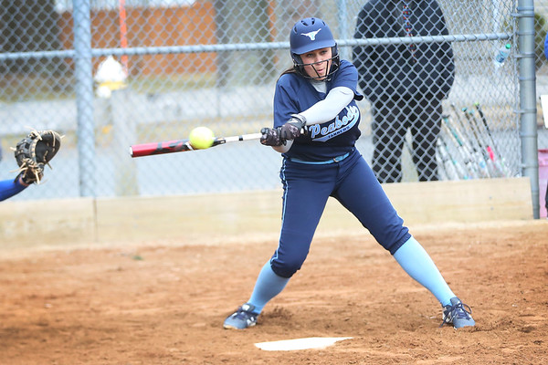 HADLEY GREEN/Staff photo<br /> Peabody's Sydney Lowry (20) hits at the Danvers v. Peabody girls softball game.<br /> <br /> 04/10/18