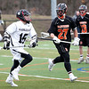 HADLEY GREEN/Staff photo<br /> Marblehead's Sam Thompson (16) runs with the ball while Beverly's Pratt (27) plays defense at the Marblehead v. Beverly boys lacrosse game at Marblehead High School.<br /> <br /> 04/19/18