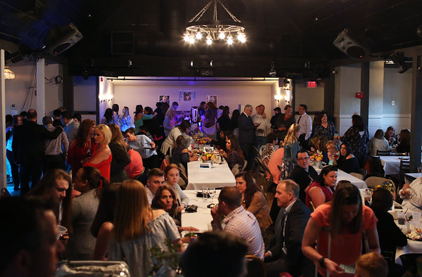 HADLEY GREEN/Staff photo<br /> Hundreds of people attended a fundraiser for Ella's Army at Breakaway in Danvers. <br /> <br /> 04/26/18