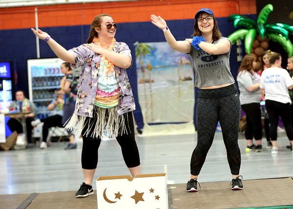 HADLEY GREEN/Staff photo<br /> From left, junior Emily Aubert and senior Shelby Barney dance at Salem State University's Relay For Life event at the O'Keefe Center. <br /> <br /> 04/20/18