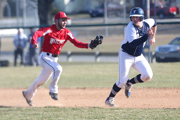 HADLEY GREEN/Staff photo<br /> Salem's Bryan Polacios (4) runs to tag out Danvers'  Zach Dillons (18) at the Danvers v. Salem boys baseball game at Twi Field in Danvers.<br /> <br /> 04/09/18