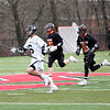 HADLEY GREEN/Staff photo<br /> Marblehead's Mason Polson (6) runs with the ball while Beverly's Smith (9) plays defense at the Marblehead v. Beverly boys lacrosse game at Marblehead High School.<br /> <br /> 04/19/18