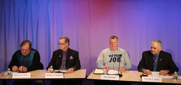 HADLEY GREEN/Staff photo<br /> Danvers selectman candidates, from left, William Clark, Gardner Trask, Stan Svensson and Thomas Ayers speak at a live candidates forum at Danvers Cable Access Television. <br /> <br /> 04/20/18